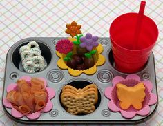 """Specific food aside, this looks like a great way to serve a meal to a child.  You could """"theme"""" it any way you want, or not at all.  Putting the cup in the muffin hole is genius."""
