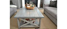 If you've been following along for awhile, you'll remember the rustic X side table I built a few months back via plans from Ana White.  The plan was to build a coordinating coffee table as well, but first we had to wait for the furniture to arrive, then figure out how to adjust her