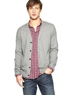 Solid cotton cardigan, printed shirt, dark wash jeans. Pair with some converses for more casual look or leather oxfords for more formal look
