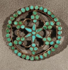 Snowflake pattern turquoise flush channel inlay pin by Frank Dishta.  Beautifully executed, labor intensive piece, using only the highest quality materials. Perfection crystalized in a snowflake pattern of wonderful symmetry that is elegant on any fabric in any season. $450