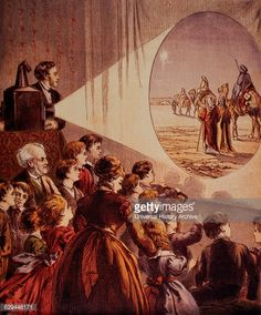 "An affluent American crowd; a man, a woman, and several children, are gathered to watch the Christmas story, that of the Three Wise Men that are searching for the Christ child. Via a, ""magic lantern"", (a projector). An image in this illustration, that is projected onto a stage curtain, c.1895.  ~ {cwl} ~ (Getty Images)"
