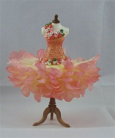 Pink Champagne SORRY I HAVE JUST SOLD Exquisite silk petal designer dress on dainty resin mannequin inches tall (1/12th scale). Bodice is made from pink sherbet fairy dust adorned with tiny embroided flowers in pink/red hues & little green leaves with genuine Swarovski aurora borealis crystal centres.on the waist, shoulder neckline & back The skirt is formed from very delicate pink/lemon silk hand layered petals.