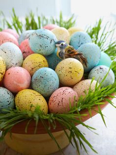 Speckled Easter Eggs  First, dye hard-cooked eggs in pastel shades. Then make flecks: Dilute brown acrylic paint with water until it's the consistency of cream. Dip an old toothbrush into the paint and, with the brush a few inches from the egg, run your finger across the bristles, splattering paint onto the shell (lay egg horizontally, splatter, let dry, rotate, and repeat).