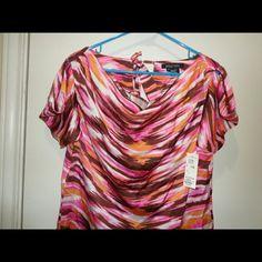 Nwt Etcetera silk blouse size 8 Beautiful blouse. Silk. Love the colors. Scoop neck.  Armpit to armpit 20  Length 24 Etcetera Tops Blouses