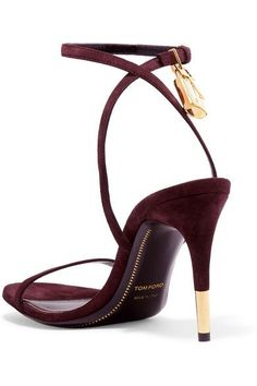 TOM FORD's sandals are decorated with the house's signature padlock charm and a gleaming gold-tipped heel. Flawlessly crafted in Italy from plum suede, the sleek ankle strap elegantly flatters your foot and provides support. Wear them with an evening dress.