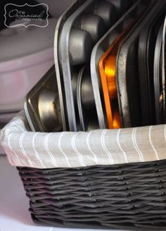 Declutter task: Baking Dishes. Use a basket to keep these neat and not always falling down. - The Organized Housewife