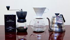 One for the coffee lovers. Hario pour over coffee system with ceramic brewer, glass carafe, buono kettle, & coffee mill skerton. These little guys not only look beeutiful but apparently make a pretty good cup. Not to be used with Sanka. I Love Coffee, Coffee Art, V60 Coffee, Coffee Cups, Home Brewing Equipment, Coffee Equipment, Cofee Shop, Blue Bottle Coffee, Pour Over Coffee