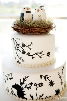 Black and white cake with bird's nest topper - Photo by Jason