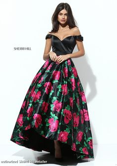 This elegant Sherri Hill 50715 dress features an A line silhouette, sweetheart neckline, and an off the shoulder. It's complete with a high low effect, tulle skirt, satin material, and fun floral print!