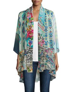 Johnny Was kimono in mixed-print georgette. V neckline; tie front. Three-quarter kimono sleeves. Flowy silhouette. Arched hem hits thigh. Silk. Machine wash. Imported.