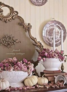 A romantic look for an Autumn Mantel. Pinks, whites, browns and aged gold all…