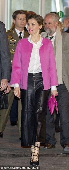 The former journalist added a pop of colour to her outfit with a fuschia pink jacket and m...
