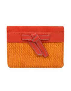 Structured bow accentuated pop toned wallet by Baggit.