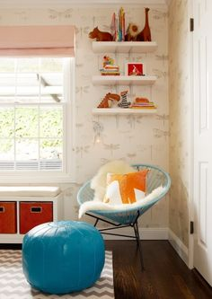 little display shelves above rocking chair with the orange hanging light