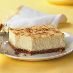 A light layer of of graham cracker crumbs adds a bit of crunch to the top of this luscious lemon cheesecake.