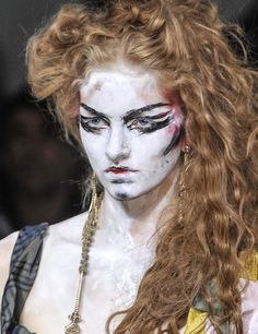 Vivienne Westwood: Brilliantly Bedraggled *After tonging brush out curls with a bristle brush.