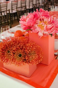 This reception table centerpieces takes a monofloral approach with the use of bright pincushions and pink peonies.
