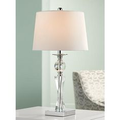 With a twist column profile and crystal glass design, this contemporary table lamp has a stunning and lavish quality.