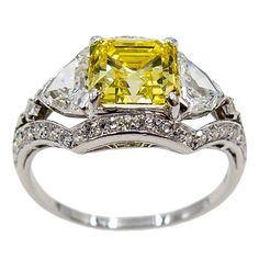 Elegant Fancy Intense GIA Cert Yellow Asscher Cut Diamond Platinum Ring   From a unique collection of vintage engagement rings at https://www.1stdibs.com/jewelry/rings/engagement-rings/
