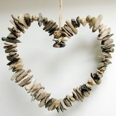 Driftwood heart idea. Mount driftwood sticks to heart shaped wire frame. Browse Driftwood Crafts at Completely Coastal: http://www.completely-coastal.com/search/label/Driftwood%20Crafts #driftwood #crafts