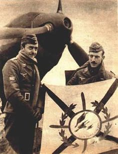 """Right, Blue Squadron pilots display their flag which reads """"Vista, Suerte y  al Toro"""". Above, inspecting a Bf 109, notice the """"España"""" patch on the  right arm."""