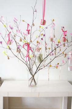 Hang flowers and ribbons from pretty tree branches to celebrate a friend's birthday! | Oh Happy Day!