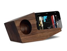 A truly wireless speaker, the geometric stand amplifies your phone's built-in speakers.