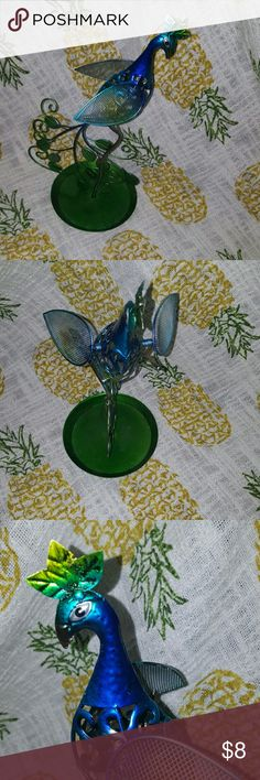 Peacock Jewelry Holder Colorful peacock jewelry holder, bottom bowl for storage and small item, wings have mesh for earrings, you can hang bracelets and necklaces. Gently used and in great condition! Claire's Jewelry