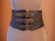 Idea: use thrift store belts as a base. Rivet leather panels to the bets to make a cincher.