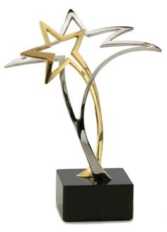 "The ""Starburst"" recognition awards celebrate those groups and individuals that push themselves to the very top of whatever pursuit they are involved in. The use of two stars is significant in that, no matter how talented we are, there is always someone or something that has supported us in our quest to be the very best. The Starburst sculpture awards are created in pewter, and are available in one of three finishes: 1) brushed pewter; 2) pewter and silver plating; and 3) gold and silver…"