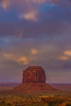 A storm brews at sunset over one of the sandstone buttes in Monument Valley, Arizona. by Jordan Edgcomb on 500px..... #sky #landscape #sunset #travel #sun #light #clouds #rock #evening #arizona #monumentvalley #storm #desert #outdoors #dusk