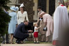 Prince George shares a tender moment with his great-grandmother the Queen, as William and his nanny watches on and Kate chats to Charles and Camilla