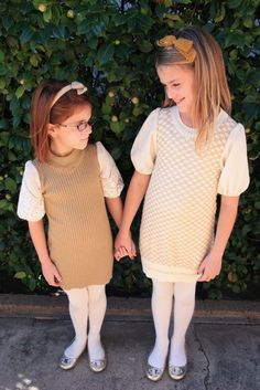 take woman's sweater, remove sleeves, re-sew side seams and sew to fit child, add sleeves w elastic at ends to make puff