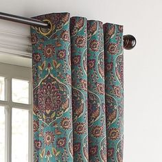 Our Ankari Curtain recreates the glory of antique Persian textiles with a multiscreen process to achieve a rich, jewel-tone print on polyester velvet. Bright, teal and burgundy bring a richness to your windows.
