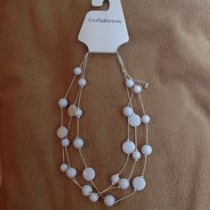White silver tone necklace New white beaded silver necklace. Has a adjustable back and also has three strands of white beads. Jewelry Necklaces