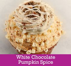 White Chocolate Pumpkin Spice   Cake: Vanilla/Pumpkin Swirl with White Chocolate Chips Filling: White Chocolate Mousse Topping: Pumpkin Spice Buttercream, White Chocolate Buttercream, White Chocolate Curls, a Dusting of Cinnamon and Nutmeg, Candied Pumpkin Seeds and Vanilla Glaze Drizzle
