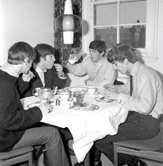 The Beatles enjoying a meal in London in October 1963