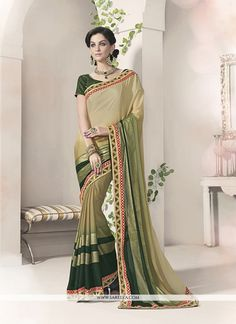 Real magnificence will come out of your dressing style and design with this green georgette and silk designer saree. This attire is displaying some really mesmerizing and inventive patterns embroidere...