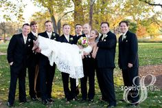 groomsmen carry bride!