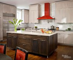 A benefit of an L-shaped kitchen is the ability to center a table in the space. This puts the family close to where the meals are prepared and draws guests near the cook when the homeowners are entertaining. The appliances are along the back wall and the refrigerator is on the side wall, which creates a large work triangle./