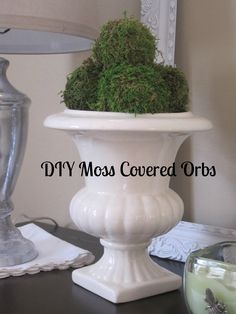 Spray paint the urn on the porch and add the PB moss orbs I bought on clearance, nice little porch decor!