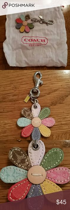 NWOT Brand New Coach Flower Key Chain Multi color Brand new never used Coach Flower Key Chain Multi color (Consider bundling to get more value out of the cost of Shipping and feel free to make offers on bundles) Thank you for visiting my closet!! SMOKE FREE CLEAN HOME Coach Accessories Key & Card Holders