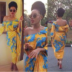 Angela Simmons box braids and beautiful African dress