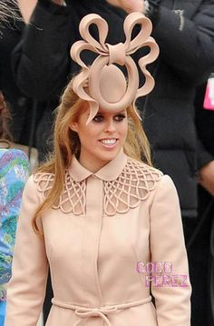 Princess Beatrice is auctioning off this fascinator she wore to Will & Kate's wedding to benefit Unicef...so, at least, some good will come from this hideous thing.