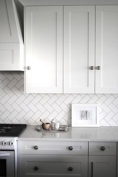 Herringbone Kitchen Tiles - 38 Examples of Kitchen Tile That You Can do Yourself ... [ more at http://diy.allwomenstalk.com ] Source If you thought the herringbone floors were awesome, you'll love how this subway tile looks on the back splash.... #Diy #Blue #Glass #Kitchen #Moroccan #Tile