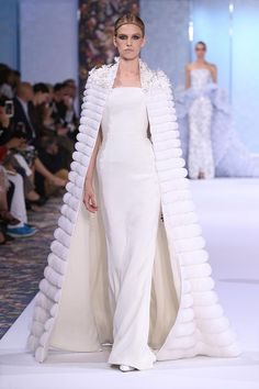 White silk crêpe dress and silk organza cape with flower cut-out shoulder embellishment and silk organza dégradé appliqué.