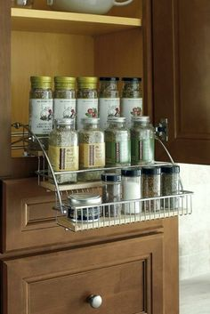 Organize your spices and pull them down to eye level with the Wall Spice Pull Down Rack by Thomasville Cabinetry. Can your kitchen ever be too organized, NOPE :) Spice Rack Inside Cabinet, Door Mounted Spice Rack, Door Spice Rack, Spice Rack Storage, Cabinet Storage, Kitchen Storage Solutions, Kitchen Organization, Home Office Cabinets, Kitchen Cabinets