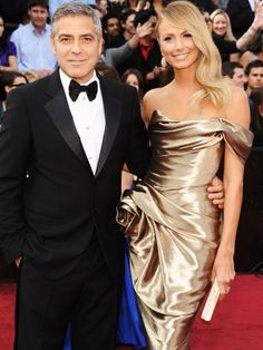 George Clooney has his own statuette on his arm: Stacey Kiebler in Marchesa.