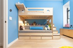 the bold blue wall and green and yellow accents beautifully contrast the birch finishes. #CasaKids #KidsFurniture