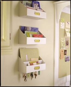Wall mounted bins labeled with family members' names keep things from getting misplaced.